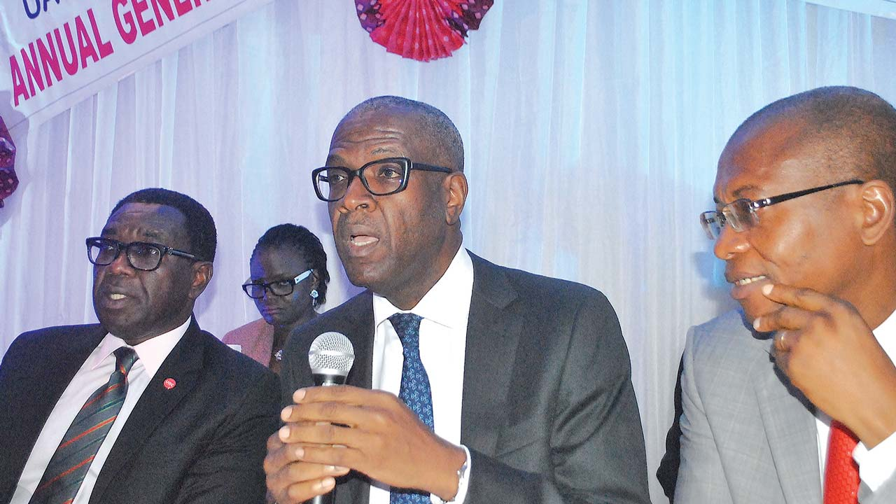 Group Managing Director, UAC of Nigeria Plc, Larry Ettah (left); Chairman, Daniel Owowr Agbor and Company Secretary, Godwin Samuel at the yearly general meeting of the company in Lagos.