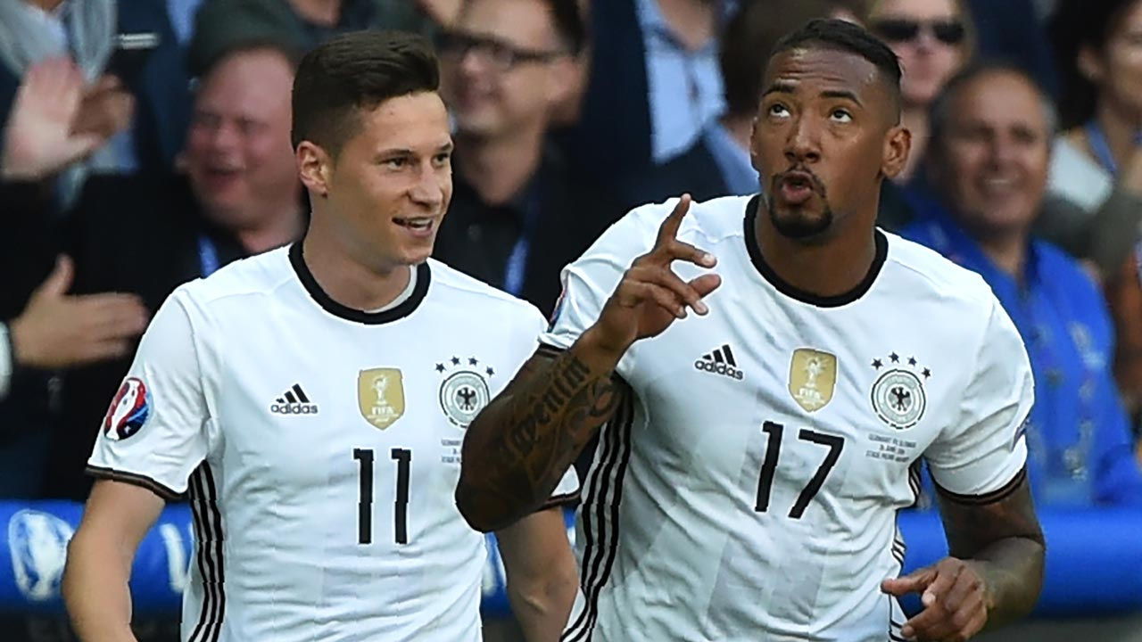 Germany's defender Jerome Boateng (R) celebrates with Germany's midfielder Julian Draxler after scoring during the Euro 2016 round of 16 football match between Germany and Slovakia at the Pierre-Mauroy stadium in Villeneuve-d'Ascq, near Lille, on June 26, 2016. PHILIPPE HUGUEN / AFP