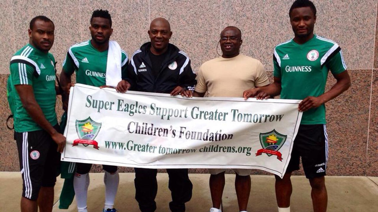 Late Stephen Keshi (third left), Paul Okoku (second right) with Super Eagles players, Vincent Enyeama, Joseph Yobo and Mikel Obi during the Super Eagles Support Greater Tomorrow Children Foundation event in Abuja.