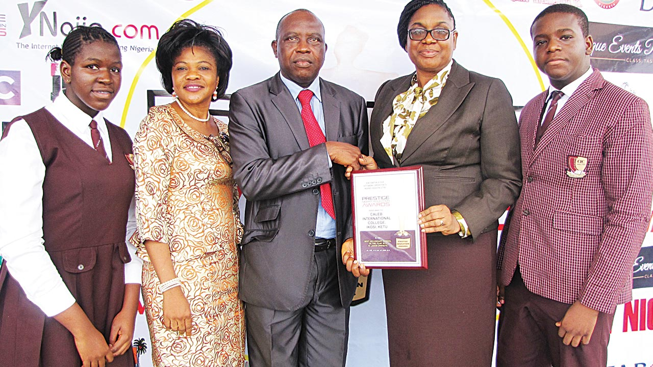 Deputy Director, Lagos State Ministry of Education, Mr Kassim Mufutau, who represented the permanent secretary, Mrs. Elizabeth Olabisi Ariyo, presenting Lagos State Best Private Secondary School Award 2015 to Principal of Caleb International College, Magodo, Mrs. Linda Olumese. They are flanked by a student of the college, Halimat Ahmadu (left); Director of Basic Education Services in the ministry, Mrs. Baiyewu Yetunde, and Master Adebisi Adeyanju.