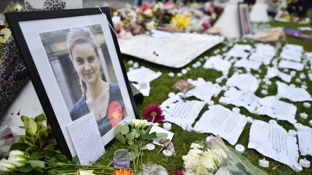Flowers and messages left in remembrance of slain Labour MP Jo Cox (photo) are pictured in Parliament Square in central London .  / AFP PHOTO / BEN STANSALL