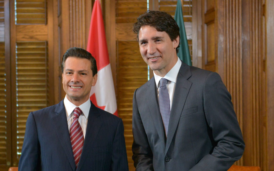 "Handout photo released by the Mexican presidential press office showing Mexican President Enrique Pena Nieto (L) and Canadian Prime Minister Justin Trudeau posing for pictures during a bilateral meeting on June 28, 2016 a day before US President Barack Obama joins them in the North American leaders' ""Three Amigos Summit"", in Ottawa, Canada. Canada will rescind travel restrictions on Mexicans at the end of this year, Trudeau told a joint press conference with Pena Nieto during the first state visit of a Mexican leader in 15 years. Mexico, meanwhile, has agreed to remove barriers to Canadian beef imports imposed after a 2003 outbreak of bovine spongiform encephalopathy (BSE), the two leaders said.  / AFP PHOTO / Mexican Presidency / HO / RESTRICTED TO EDITORIAL USE - MANDATORY CREDIT ""AFP PHOTO / MEXICAN PRESIDENCY"