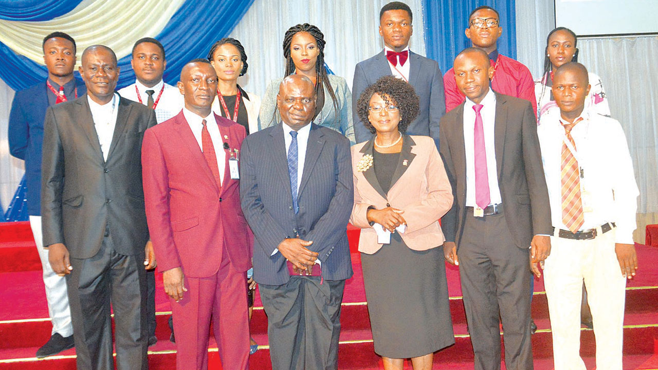 The seven Landmark University students, who won the CODET and members of staff of the school after the competition.