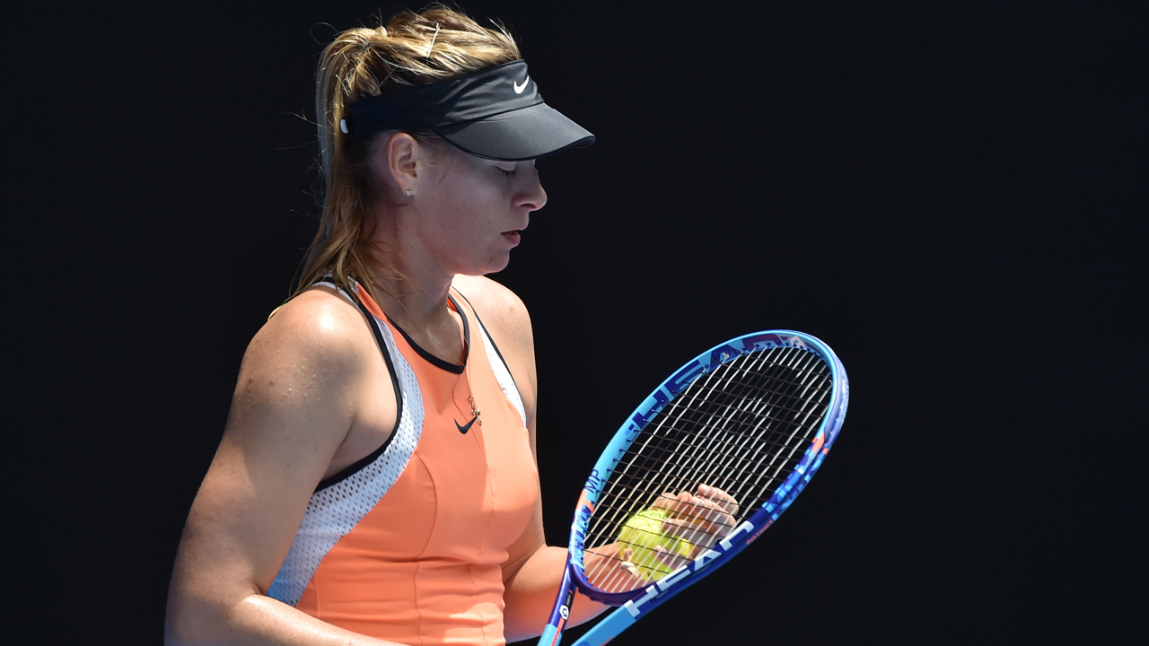 (FILES) This file photo taken on January 26, 2016 shows Russia's Maria Sharapova preparing to serve during her women's singles match against Serena Williams of the US on day nine of the 2016 Australian Open tennis tournament in Melbourne. Russian tennis star Maria Sharapova has been banned for two years after failing a drug test, the International Tennis Federation (ITF) announced on June 8, 2016. Sharapova tested positive for the controversial banned medication meldonium during January's Australian Open. / AFP PHOTO / PAUL CROCK