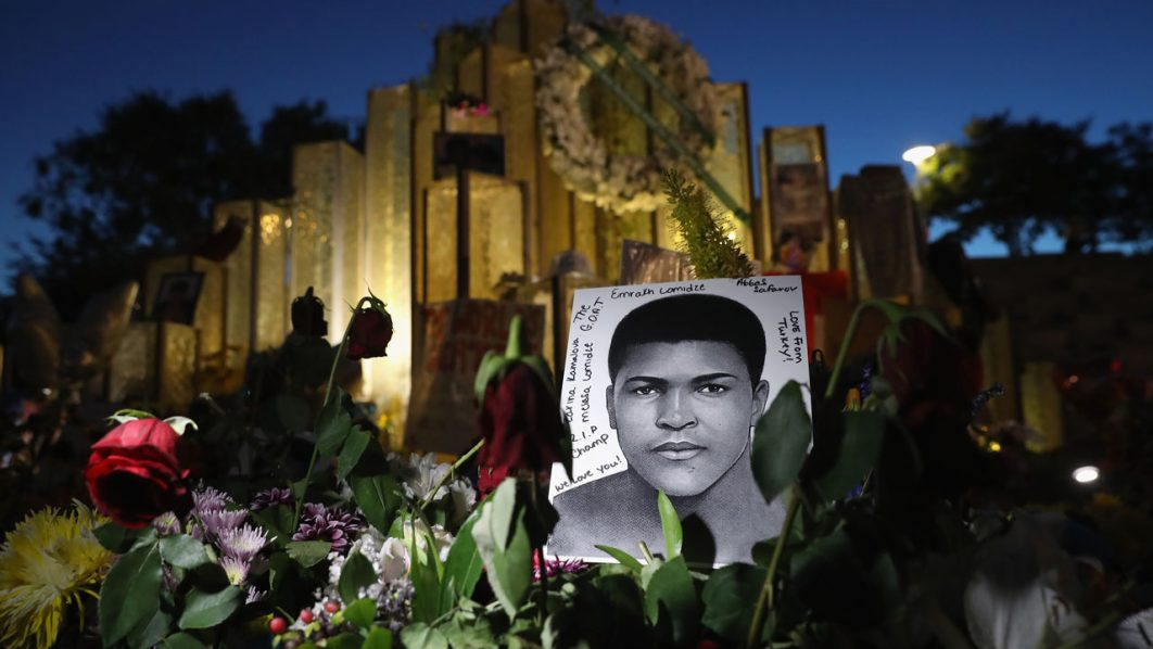 LOUISVILLE, KY - JUNE 08: A portrait of Muhammad Ali, under a crescent moon, stands at a memorial outside the Muhammad Ali Center on June 8, 2016 in Louisville, Kentucky. A funeral procession and memorial service for the four-time world heavyweight boxing champion, who died on June 3 at age 74, is scheduled for Friday in Louisville. John Moore/Getty Images/AFP