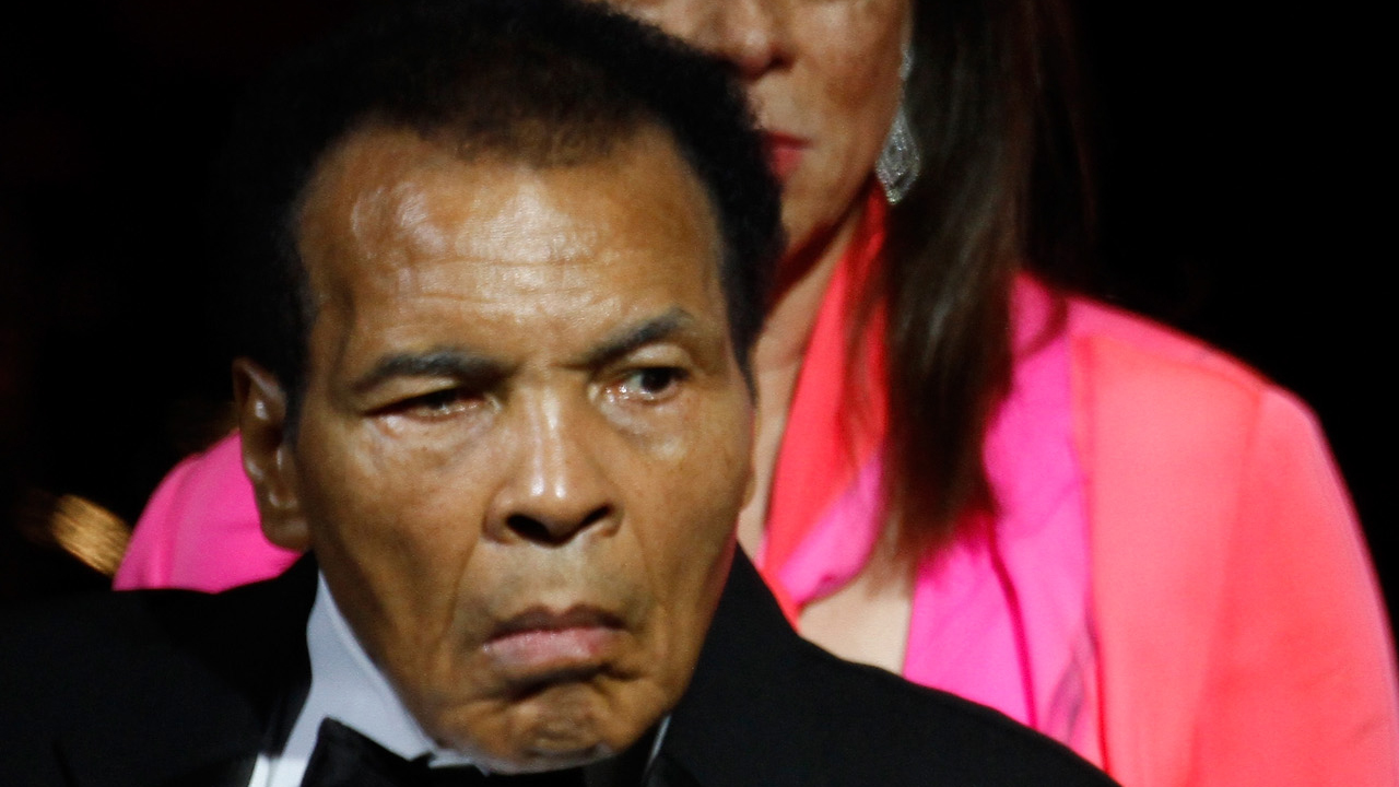 (FILES) This file photo taken on March 22, 2013 shows Muhammad Ali, Lonnie Ali, and Dennis Washington attending Muhammad Ali's Celebrity Fight Night XIX at JW Marriott Desert Ridge Resort & Spa in Phoenix, Arizona. Boxing legend Muhammad Ali, dies at 74. The former heavyweight world champion was hospitalized on Thursday at a Phoenix, Arizona, hospital with a respiratory issue, which US media reported was complicated by his Parkinson's disease. / AFP PHOTO / GETTY IMAGES NORTH AMERICA / Mike Moore
