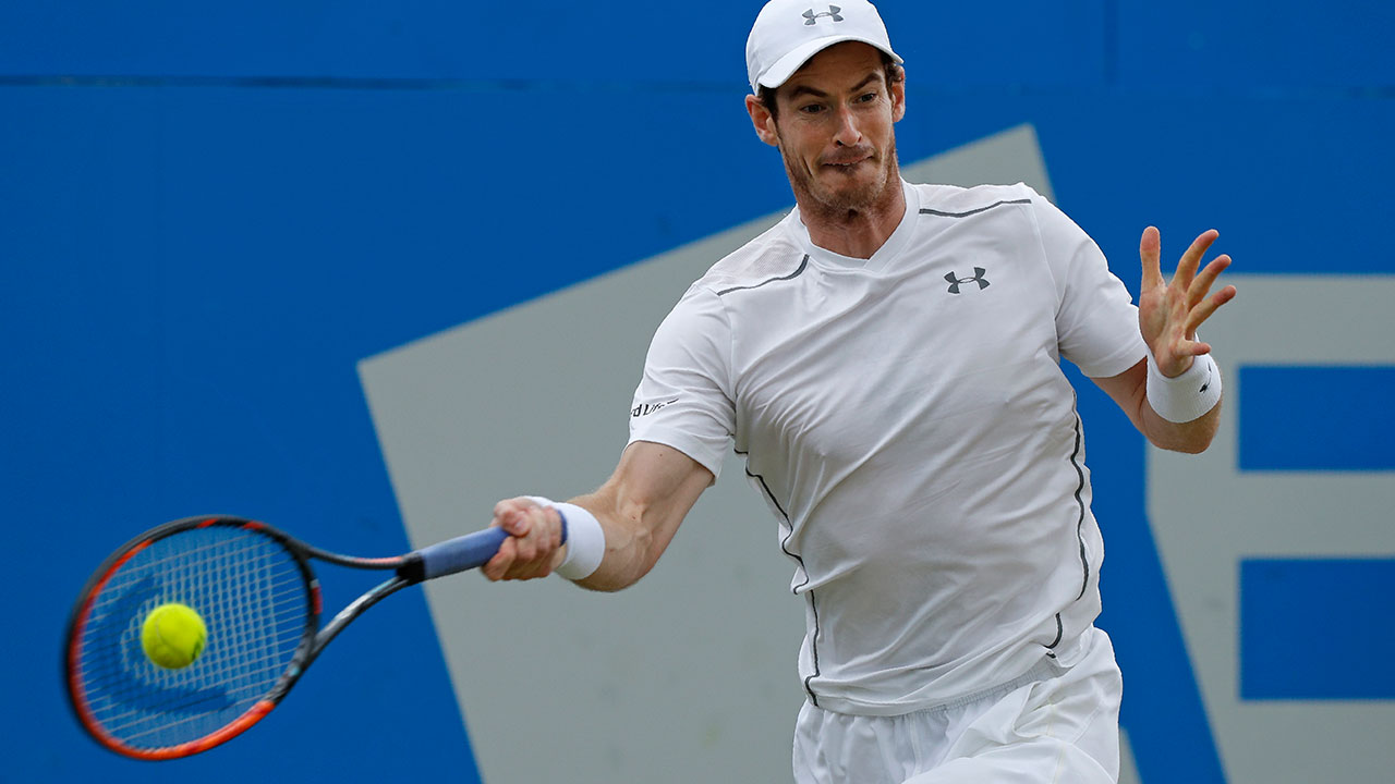 Britain's Andy Murray returns to Croatia's Marin Cilic during their men's singles semi-final match in the ATP Aegon Championships tennis tournament at the Queen's Club in west London on June 18, 2016. Murray won the match 6-3, 4-6, 6-3. ADRIAN DENNIS / AFP