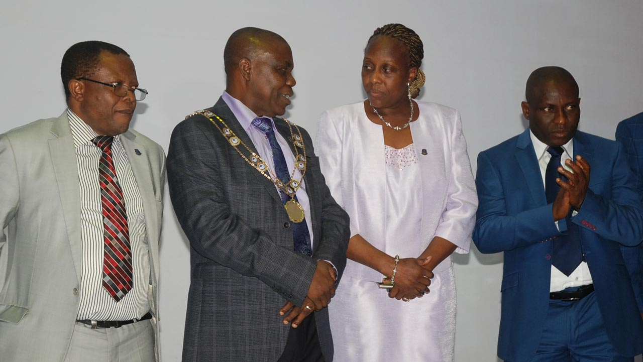 First Vice President, Nigerian Institution of Estate Surveyors and Valuers(NIESV), Rowland Abonta; NIESV President, Dr. Bolarinde Joshua Patunola-Ajayi; His wife, Olayinka; and Second Vice President, Emma Okas Wike at the 22nd investiture reception of NIESV President in Lagos recently                      PHOTO: SUNDAY AKINLOLU