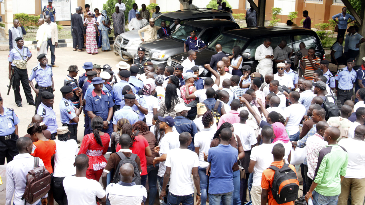 Youths sacked by Nigerian Immigration Service(NIS) protesting their unceremonial disengagement in Abuja on Tuesday, June 14, 2016. PHOTO: LADIDI LUCY ELUKPO
