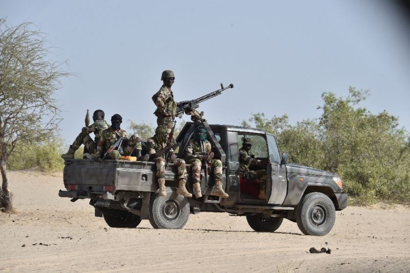 Nigerien soldiers pictured patrolling near the Nigerian border in 2015, when the country was first plagued by Boko Haram attacks in its southeast region (AFP Photo/Issouf Sanogo)