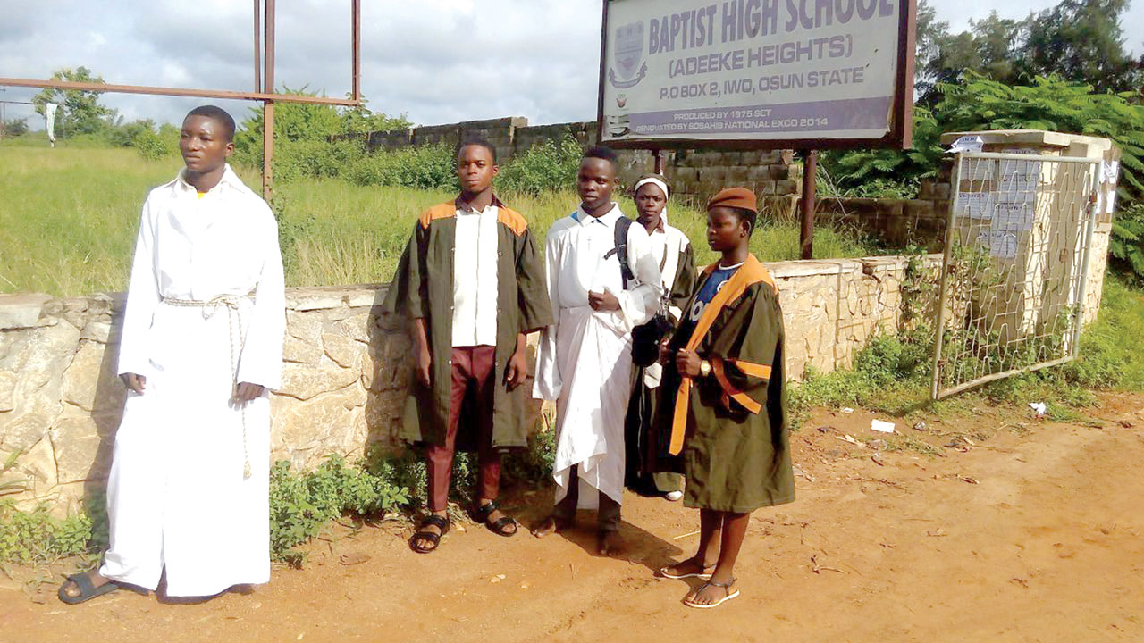 Some students of Baptist High School. Iwo in church vestments