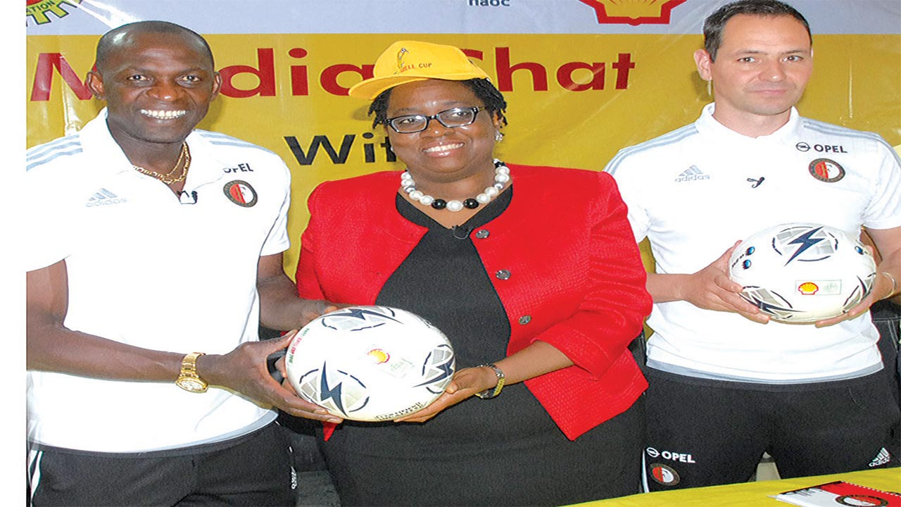 Super Eagles' former striker, Mike Obiku, who is now a coach at Feyenoord Academy, Holland, (left); Communications Manager, SPDC, Sola Abule; and Manager, International Relations, Feyenoord Academy, Gido Vader, during the unveiling of the programme for the Shell Cup semifinals, which hold in Lagos…today.