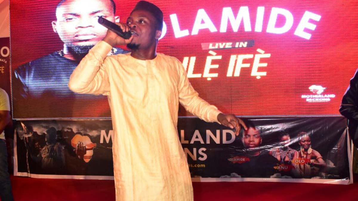 Olamide performing at the event
