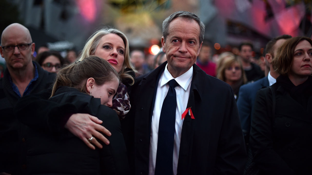 Australia's opposition leader Bill Shorten (R) with his Wife Chloe (L) and daugher Georgette (C) attend a gthering to show solidarity with the Orlando shooting victims, in Melbourne on June 16, 2016. The assault, which left 50 people dead including the shooter, is the worst mass shooting in modern US history, and has triggered an outpouring of grief but also defiance in the gay and lesbian community in the United States and around the world. SAEED KHAN / AFP