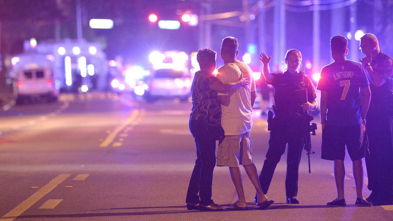 Orlando police officers direct family members away from a multiple shooting at a nightclub on Sunday. PHOTO: PHELEN M. EBENHACK/ASSOCIATED PRESS