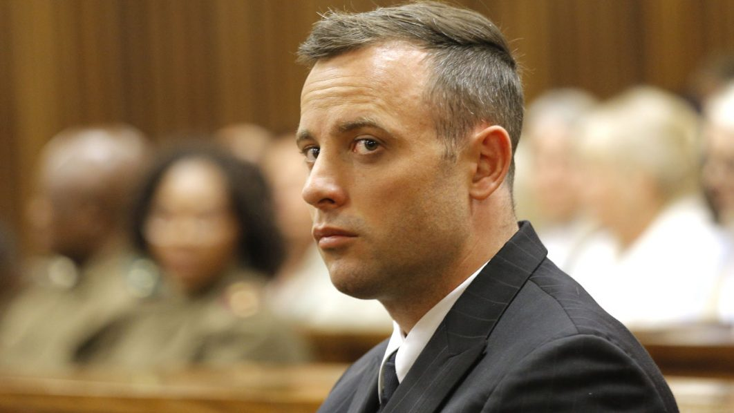 South African Paralympian Oscar Pistorius looks on inside the dock at the high court in Pretoria, on June 14, 2016 on the second day of South African Paralympian Oscar Pistorius pre sentencing hearing set to send him back to jail for murdering his girlfriend three years ago. The double-amputee killed Reeva Steenkamp, a model and law graduate, in the early hours of Valentine's Day in 2013, saying he mistook her for an intruder when he fired four times through the door of his bedroom toilet. / AFP PHOTO / POOL / Kim LUDBROOK