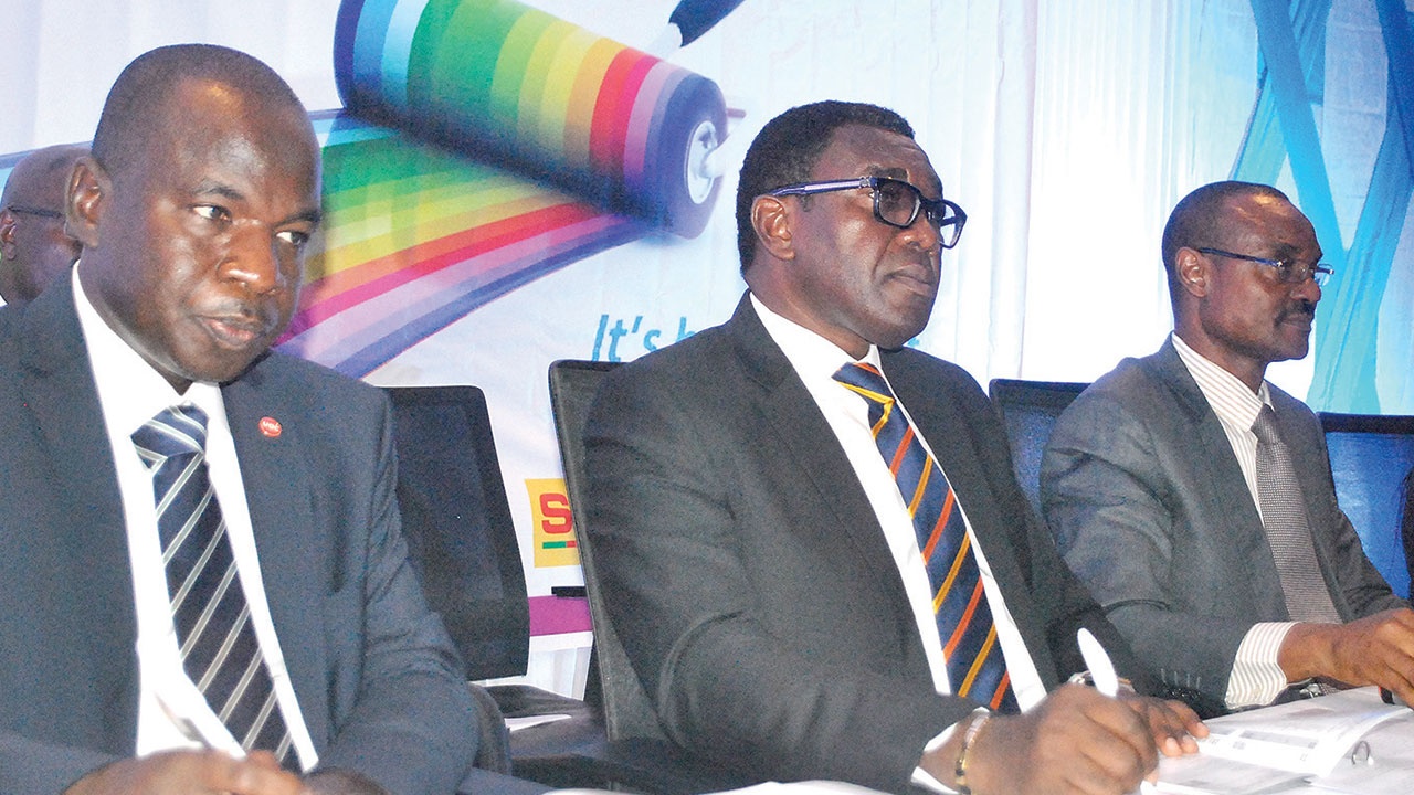 Managing Director, Portland Paints Product Nigeria Plc, Mukhtair Yakasai (left); Chairman, Larry Ettah; and Company Secretary, Adeleke Yusuff, during the yearly general meeting of the company in Lagos.