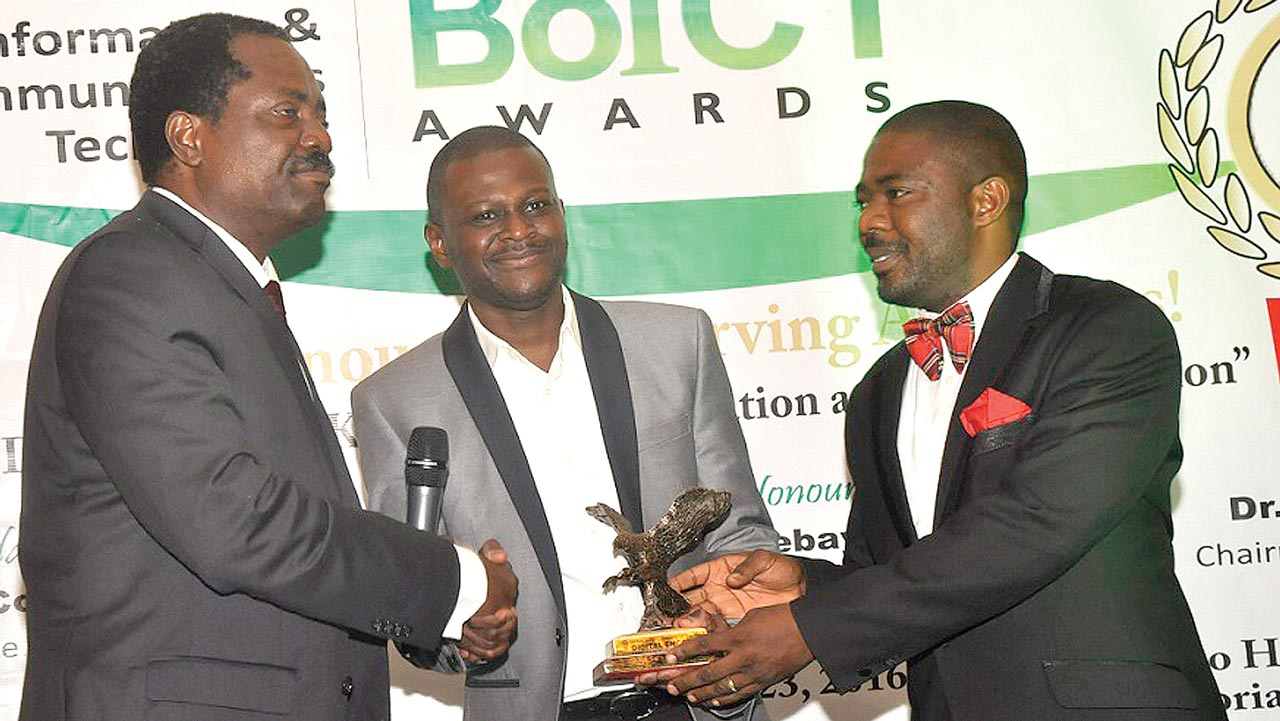 Engr. Lanre Ajayi, former president, Association of Telecommunications Companies of Nigeria (ATCON) presenting Cybersecurity Company of the Year Award to Oluseyi Akindeinde, chief technical officer, Digital Encode while Adewale Obadare, chief operating officer, Digital Encode looks on, at the just concluded Beacon of ICT Awards held in Lagos recently