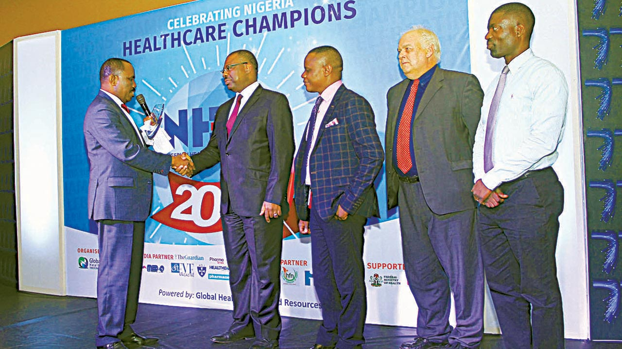 Reddington Hospital's Chief Operating Officer, Mr. Emmanuel Matthews (2nd left), receiving the 2016 Nigerian Healthcare Excellence Awards (NHEA) award for Best Private Healthcare Provider, Clinical Director, Dr. Charles Iwuala, Business Development Director, Mr. Andy Cunliffe and Chief Physiotherapist, Lanre Osho during the ceremony held in Eko Hotel and Suites, Lagos.