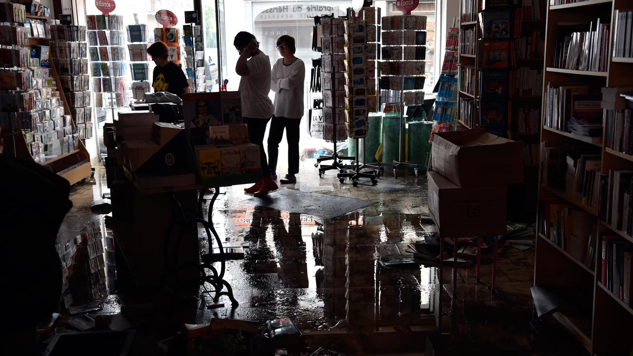 "A devastated bookstore is pictured on June 2, 2016 in Montargis, some 130 kilometers south of Paris, following floods caused by heavy rainfalls. Some towns in central France are suffering their worst floods in more than a century, with more than 5,000 people evacuated since the weekend. Forecaster Meteo France described the situation as ""exceptional, worse than the floods of 1910"", when even central Paris was flooded. ALAIN JOCARD / AFP"