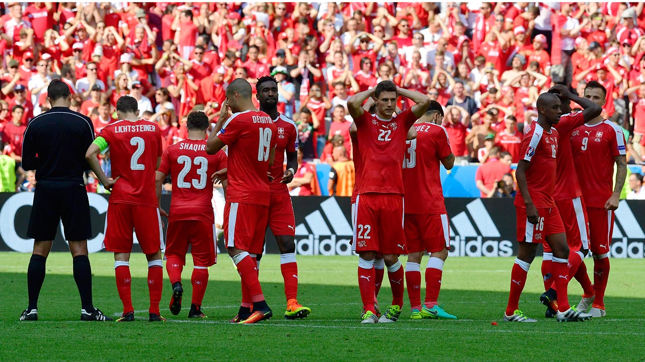 Switzerland's players react after loosing the penalty shoot-out during the Euro 2016 round of sixteen football match Switzerland vs Poland, on June 25, 2016 at the Geoffroy Guichard stadium in Saint-Etienne. TOBIAS SCHWARZ / AFP