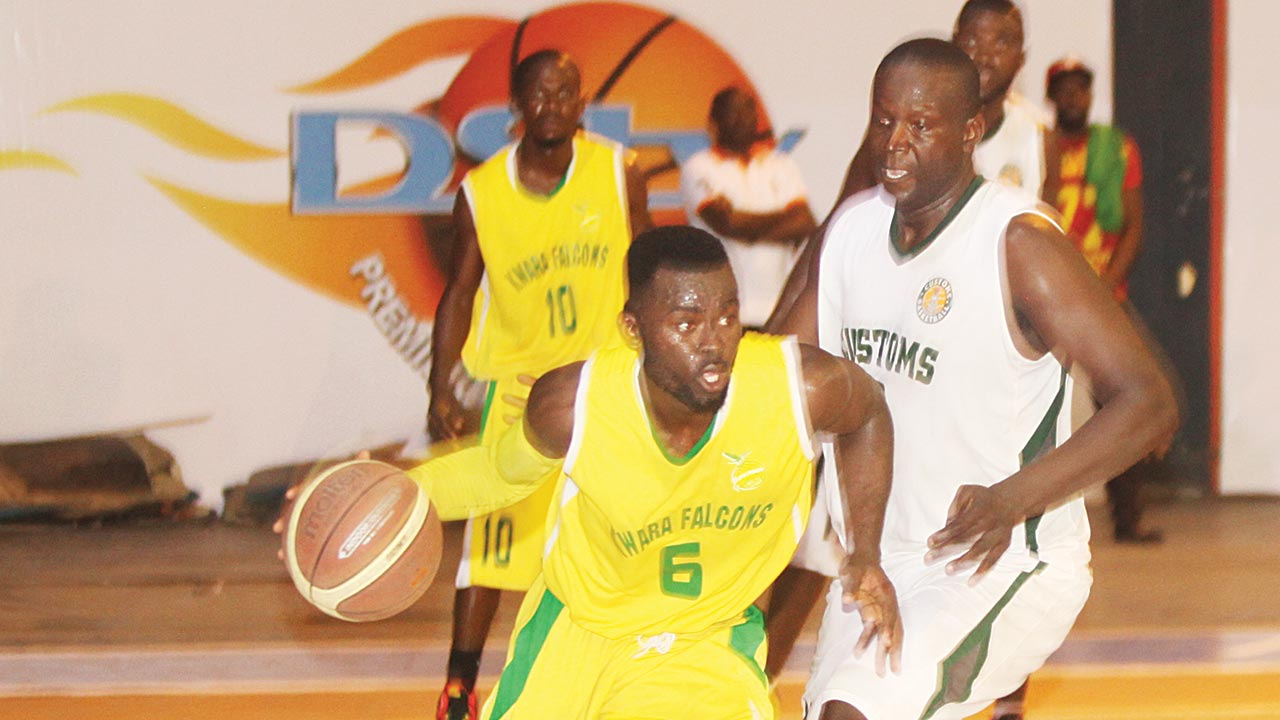 Kwara Customs' Ajileye Seyi (left) trying to beat a Nigeria Customs player during their DStv Basketball League game held at the Indoor Sports Hall of National Stadium Lagos… at the weekend.