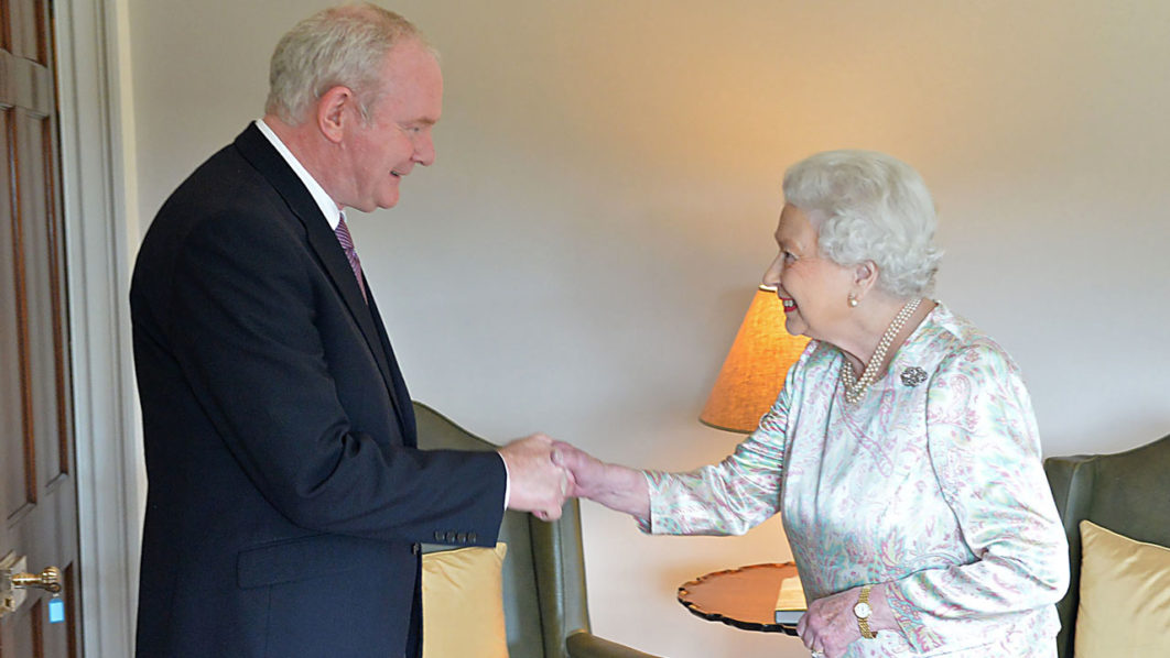 In this handout image received from the Northern ireland Office on June 27, 2016, Britain's Queen Elizabeth II shakes hands with Northern Ireland Deputy First Minister Martin McGuinness (L) at Hillsborough Castle, south of Belfast on June 27, 2016 on the start of a two day visit to the province. / AFP PHOTO / Northern Ireland Office / Aaron McCracken/Harrisons 07778