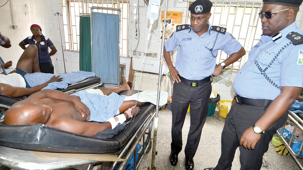 Owoseni and his deputy, Adeoye Fimihan during a visit to the shot policeman in the hospital