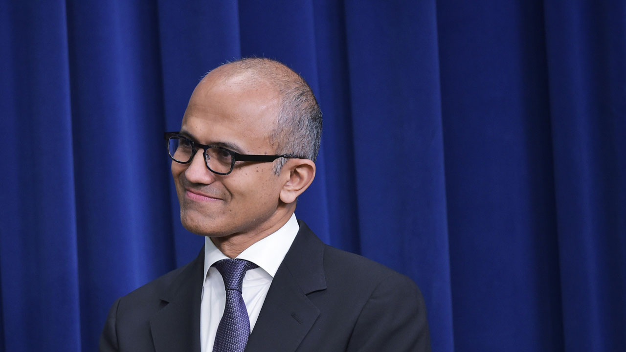 "(FILES) This file photo taken on April 16, 2015 shows Microsoft CEO Satya Nadella as he watches US President Barack Obama deliver remarks at the Eisenhower Executive Office Building in Washington, DC. Microsoft said June 13, 2016 it signed a deal to acquire the professional social network LinkedIn for $26.2 billion in cash. ""The LinkedIn team has grown a fantastic business centered on connecting the world's professionals,"" Microsoft chief executive Satya Nadella said. / AFP PHOTO / MANDEL NGAN"