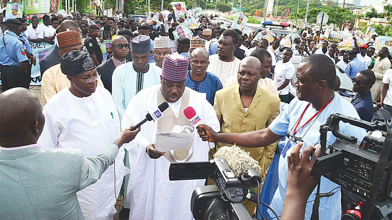 Senator Ali Modu Sherrif (middle) at the Peoples Democratic Party (PDP) National Headquarters with his supporters addressing the press, during a protest in Abuja PHOTO: LADIDI LUCY ELUKPO