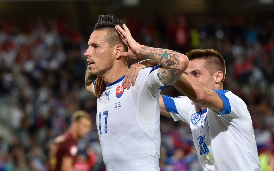 Slovakia's midfielder Marek Hamsik celebrates his goal during the Euro 2016 group B football match between Russia and Slovakia at the Pierre-Mauroy Stadium in Villeneuve-d'Ascq, near Lille, on June 15, 2016. / AFP PHOTO / PHILIPPE HUGUEN