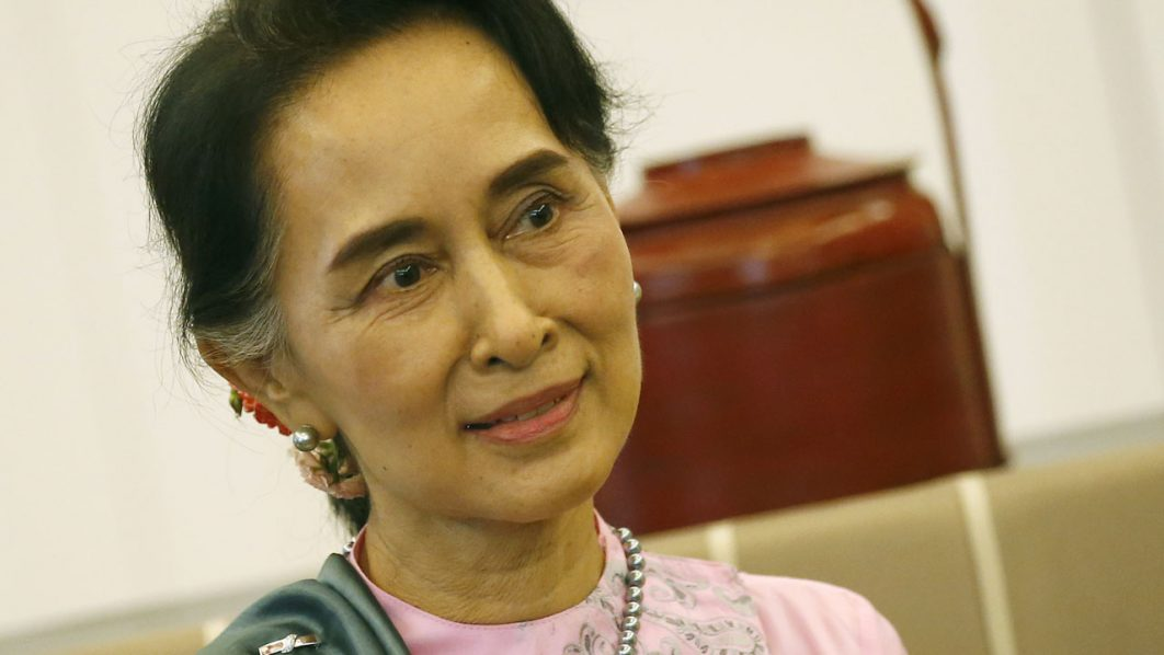 Myanmar Foreign Minister and State Counsellor Aung San Suu Kyi sits in the VIP room upon her arrival at Suvarnabhumi airport in Bangkok on June 23, 2016. Myanmar's Aung San Suu Kyi arrived on June 23 in Thailand where she was expected to be garlanded by her adoring compatriots, hundreds of thousands of whom have sought work and sanctuary from war across the border. / AFP PHOTO / POOL / NARONG SANGNAK