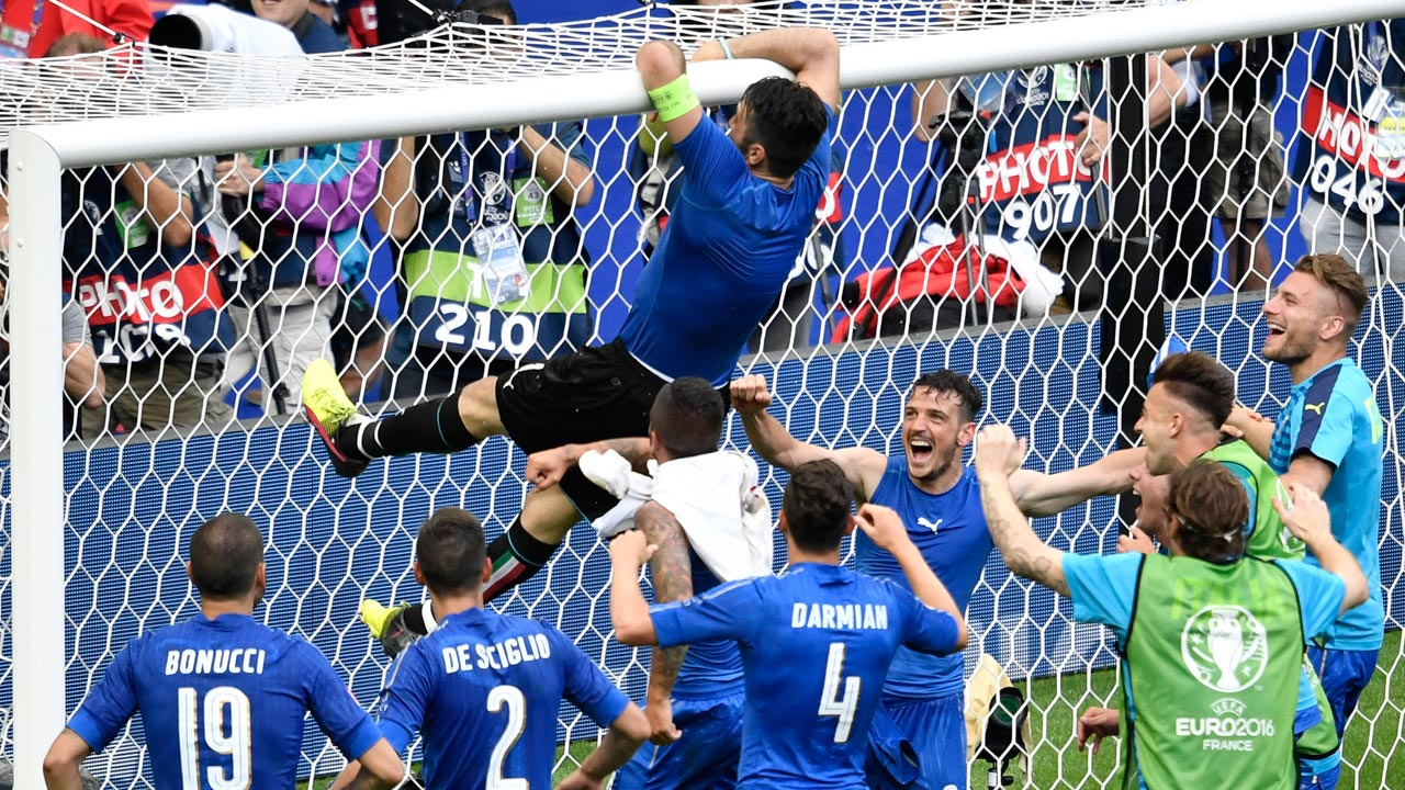 Italy's goalkeeper, Gianluigi Buffon (top), climbs to the goal's crossbar as they celebrate their Euro 2016 round of 16 victory over Spain…yesterday. PHOTO: AFP