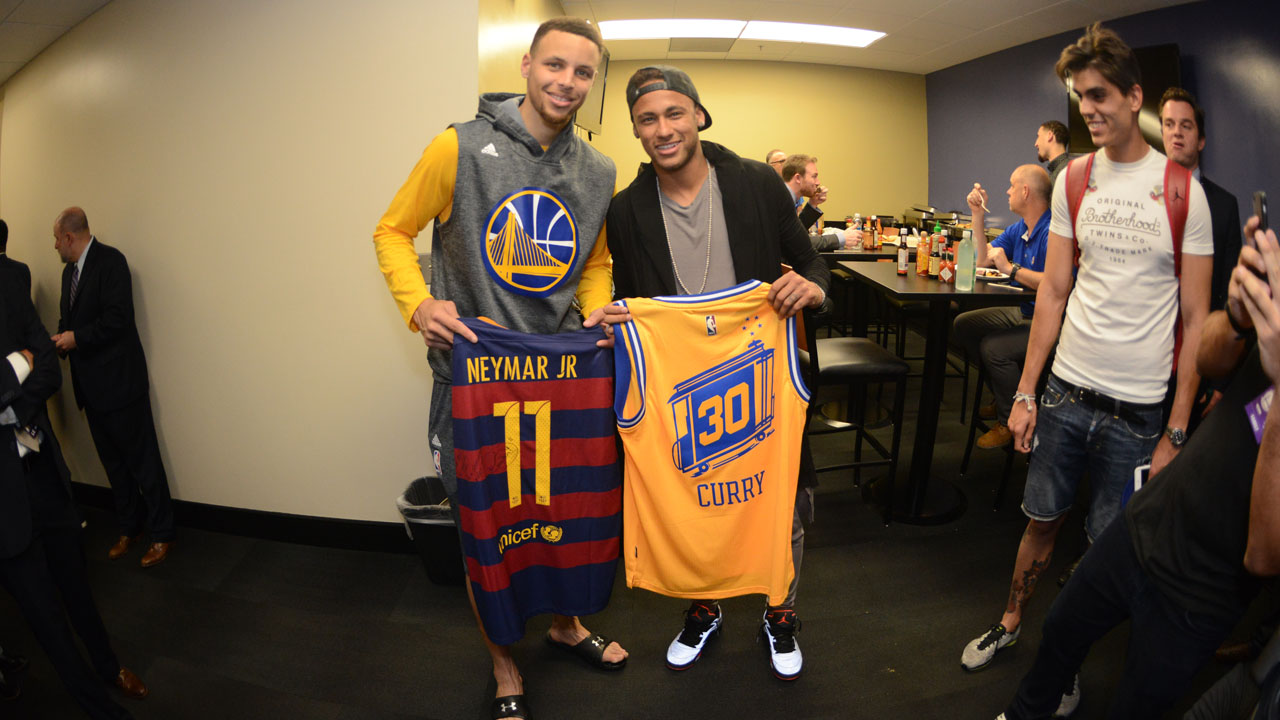 OAKLAND, CA - JUNE 5: Stephen Curry #30 of the Golden State Warriors poses with Neymar, professional soccer player after Game Two of the 2016 NBA Finals against the Cleveland Cavaliers on June 5, 2016 at ORACLE Arena in Oakland, California.   Noah Graham/NBAE via Getty Images/AFP