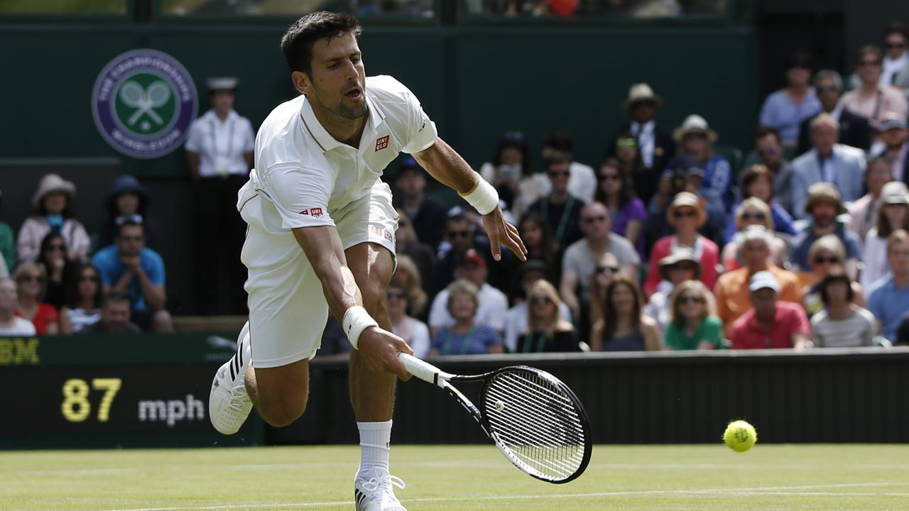 Serbia's Novak Djokovic returns against Britain's James Ward during their men's singles first round match on the first day of the 2016 Wimbledon Championships at The All England Lawn Tennis Club in Wimbledon, southwest London, on June 27, 2016. ADRIAN DENNIS / AFP