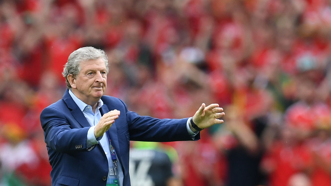 England's coach Roy Hodgson celebrates after the Euro 2016 group B football match between England and Wales at the Bollaert-Delelis stadium in Lens on June 16, 2016. England won the match 2-1. / AFP PHOTO / PAUL ELLIS