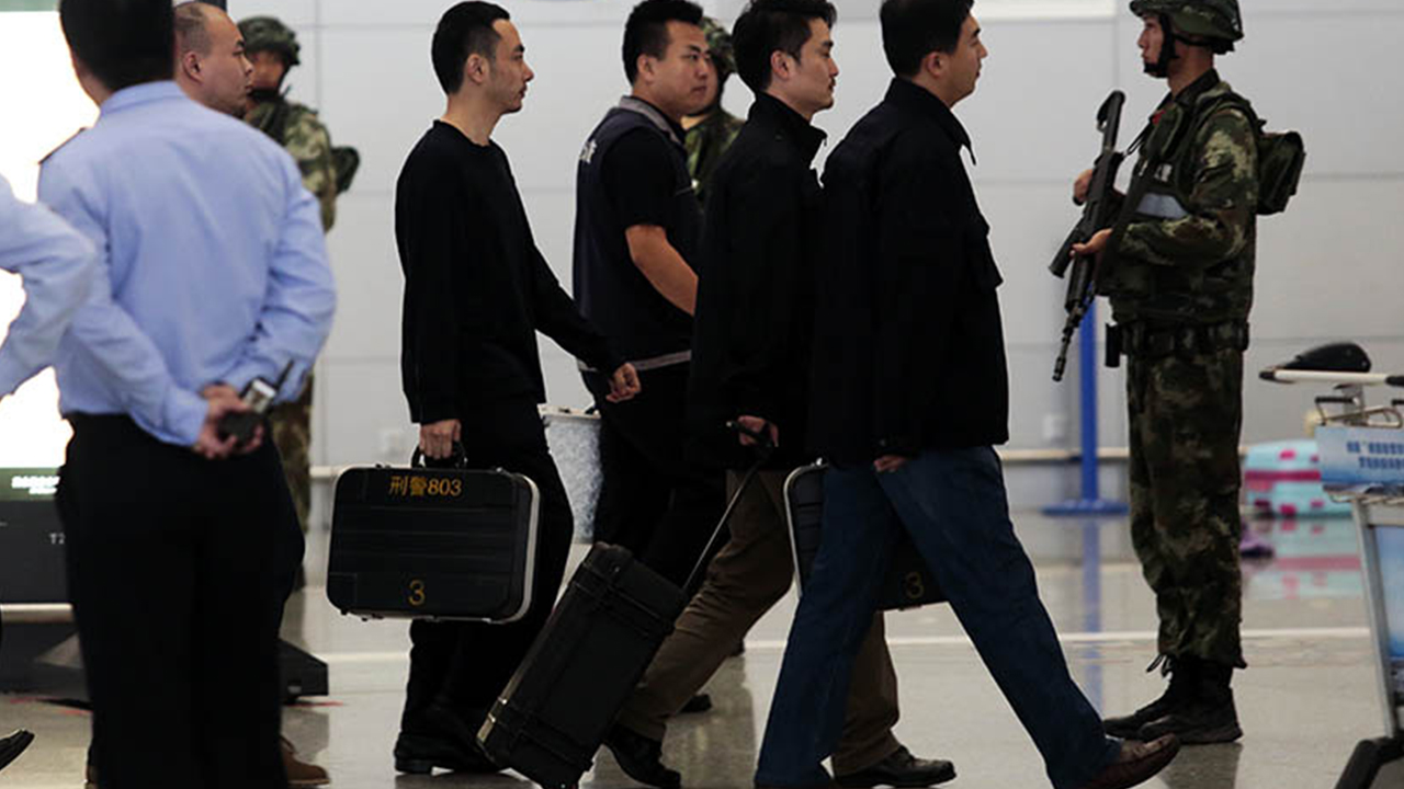 A group of police detectives at the scene of the explosion at Shanghai Pudong International Airport.