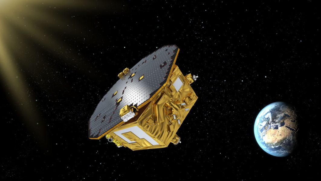 (FILES) This handout file image taken on November 26, 2015 and obtained from the European Space Agency on November 29, 2015 shows an artist's impression of the LISA Pathfinder, ESA's mission to test technology for future gravitational-wave observatories in space.  The European Space Agency's LISA Pathfinder experiment was launched last December to set up an ambitious mission to observe gravitational waves from space. Europe will tackle the construction of its future space observatory, eLISA, and search for gravitional waves in the depths of the universe.  / AFP PHOTO / ESA / HO /