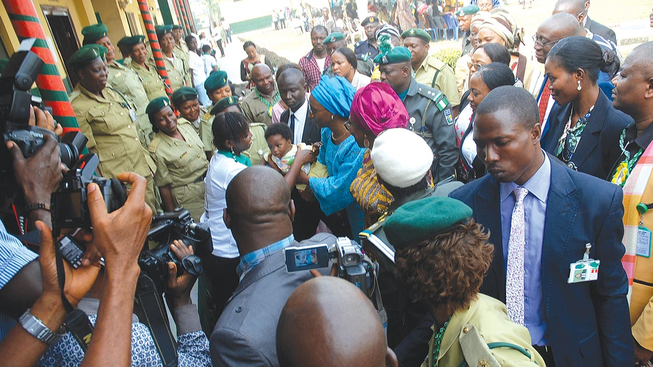 Wife of Vice President, Dolapo Osinbajo carrying a baby prisoner during her recent visit