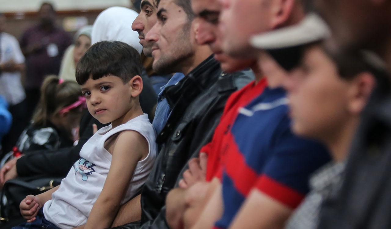 Syrian migrants AFP PHOTO / STR /