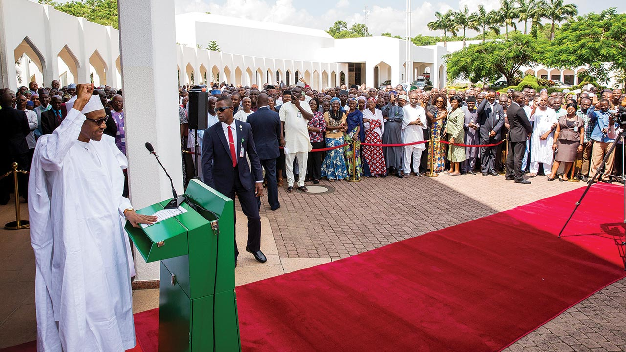 President Muhammadu Buhari addressing State House workers during his first formal meeting with them at the Presidential Villa, Abuja …yesterday PHOTO: Philip Ojisua
