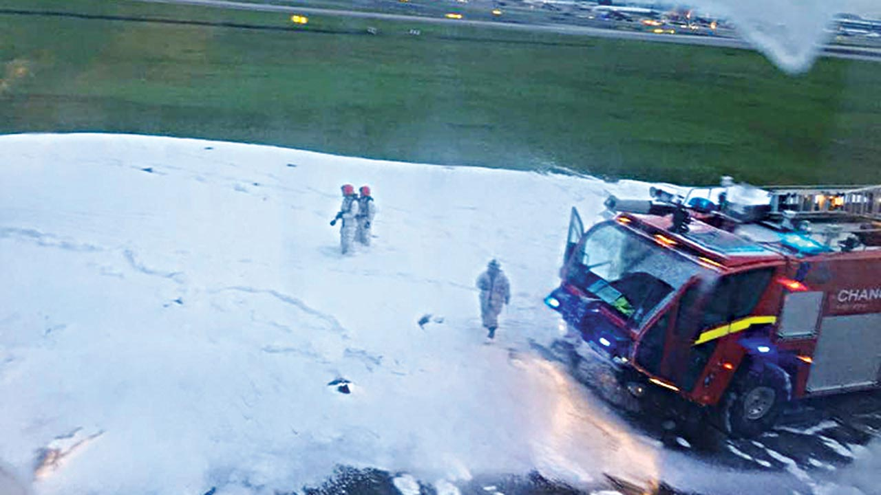 Foam on the tarmac of Changi Airport after firefighters put out a fire on the right wing of a Singapore Airlines aircraft while making an emergency landing after turning back from Milan due to engine problem …yesterday. PHOTO: AFP