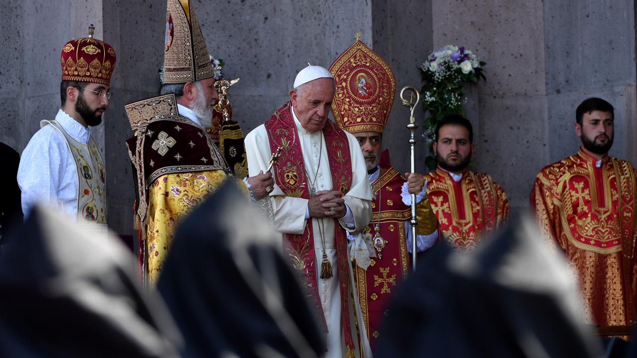 Pope Francis and Catholicos of All Armenians Karekin attend the Divine Liturgy at the Apostolic Cathedral in Etchmiadzin, outside Yerevan, on June 26, 2016. TIZIANA FABI / AFP