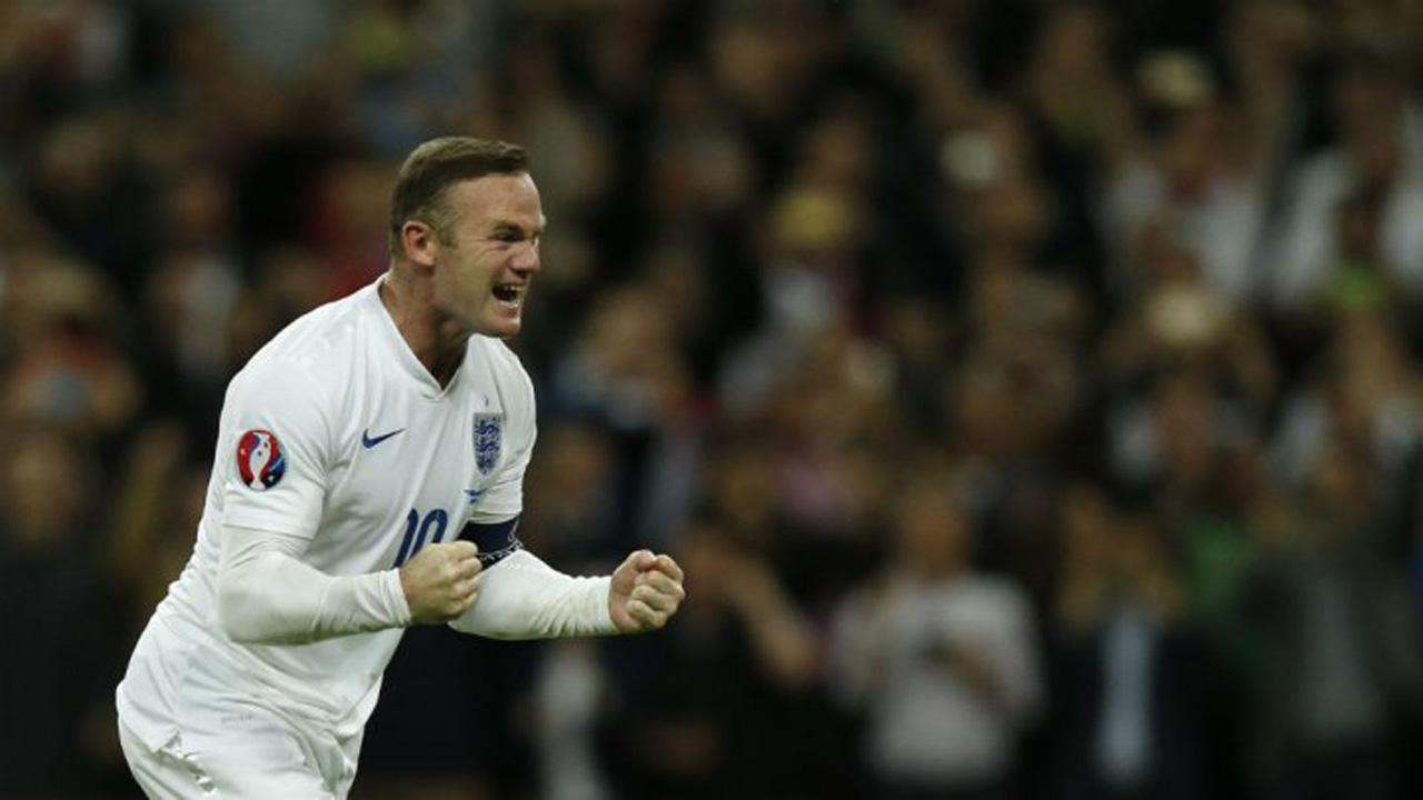 Adrian Dennis, AFP | Wayne Rooney celebrates after scoring his 50th England goal