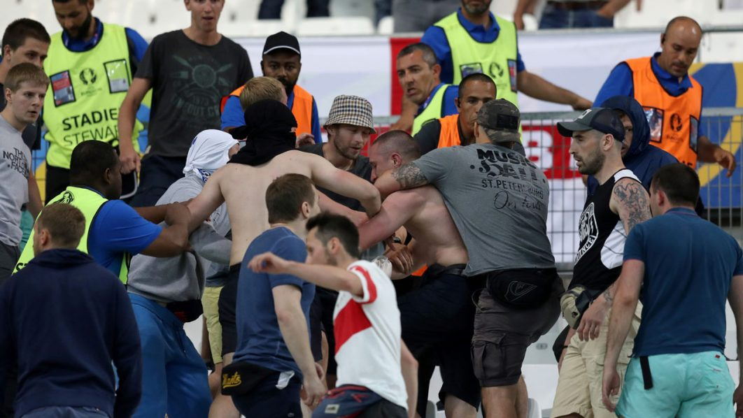 Groups of supporters clash fight at the end of the Euro 2016 group B football match between England and Russia at the Stade Velodrome in Marseille on June 11, 2016. / AFP PHOTO / Valery HACHE