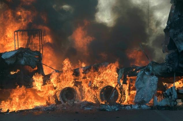 A truck is set alight in Atteridgeville, west of Pretoria, on June 21, 2016. Mujahid Safodien (AFP)