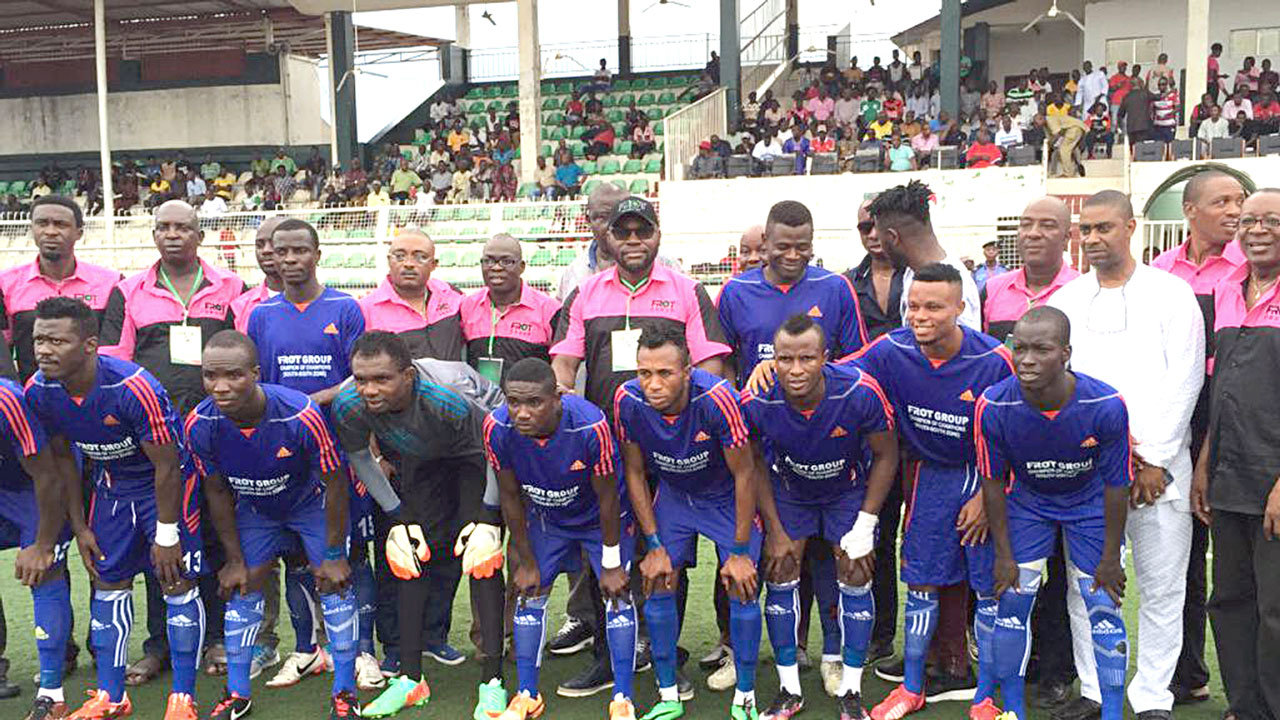Frank Momoh (seventh standing from left), and chairman of Edo FA, Frank Ilaboya (sixth standing) with players and officials of Bendel Insurance FC after winning the maiden South-south Champion of Champions football tournament in Benin City.