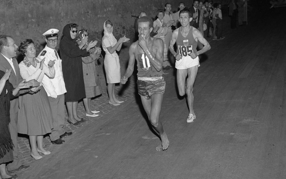 TO GO WITH AFP STORY BY CYRIL BELAUD (FILES) This file photo taken on September 10, 1960 shows Ethiopian athlete Abebe Bikila  running barefoot for victory during the Rome 1960 Olympic Games marathon, after passing Moroccan Abdeslam Radi. Ethiopia's athlete Abebe Bikila, the legendary bare foot runner opened the way to the Olympic glory to African runners, with his victory in the marathon during the 1960 Olympic Games edition in Rome, before dying in a car accident. / AFP PHOTO / EPU / -