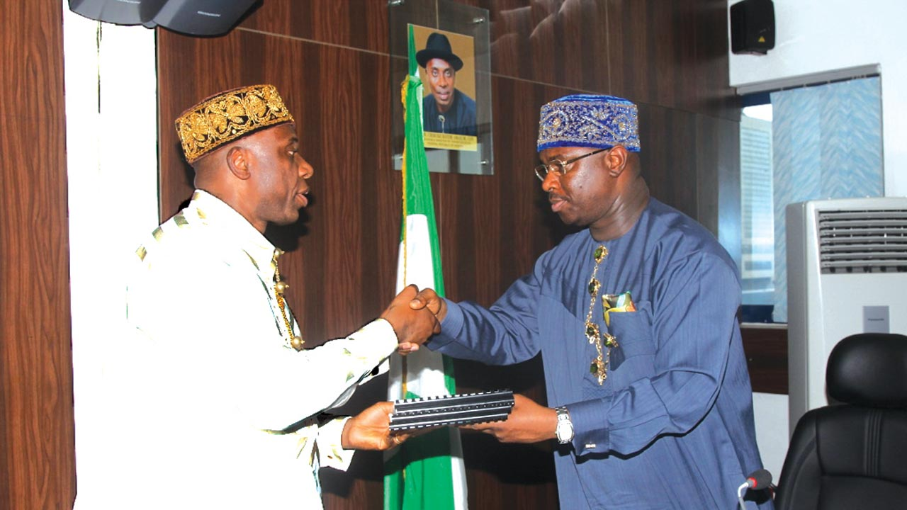 Minister of Transportation, Chibuike Rotimi Amaechi (left); receiving the report of the Ministerial Committee on National Maritime and Safety Agency (NIMASA) from the Committee chairman and Director-General of the agency, Dakuku Peterside, in Abuja.