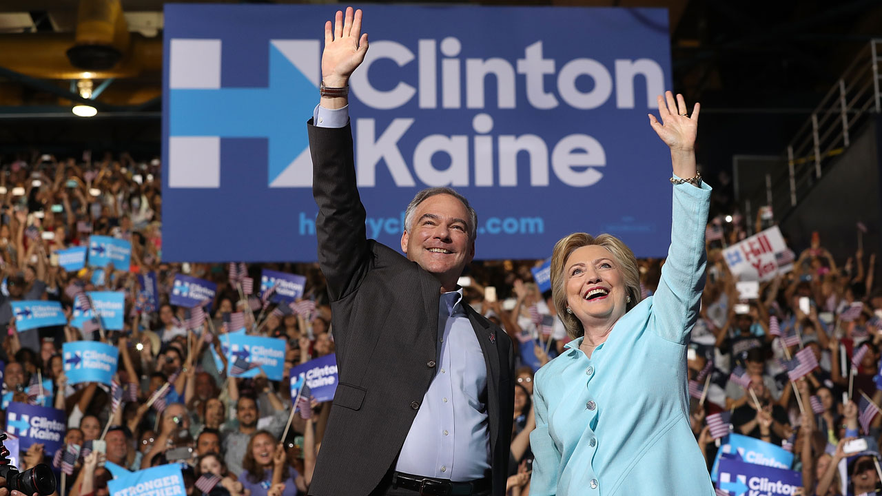 MIAMI, FL - JULY 23: Democratic presidential candidate former Secretary of State Hillary Clinton and Democratic vice presidential candidate U.S. Sen. Tim Kaine (D-VA) greet supporters during a campaign rally at Florida International University Panther Arena on July 23, 2016 in Miami, Florida. Hillary Clinton and Tim Kaine made their first public appearance together a day after the Clinton campaign announced Senator Kaine as the Democratic vice presidential candidate. Justin Sullivan/Getty Images/AFP JUSTIN SULLIVAN / GETTY IMAGES NORTH AMERICA / AFP
